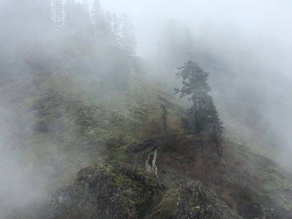 stairs on mountain slope in the clouds