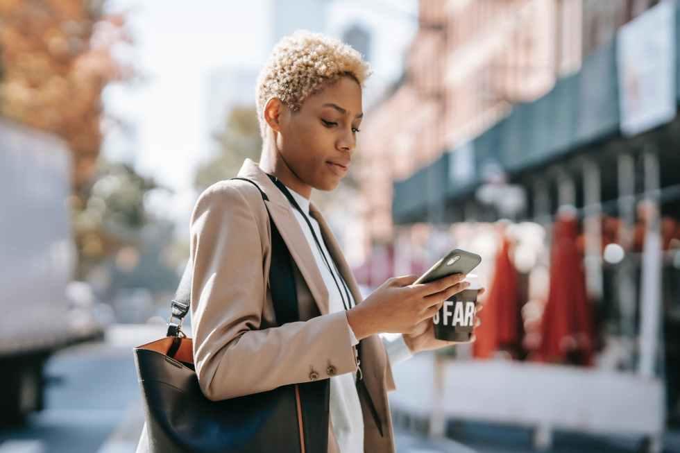 focused woman messaging on smartphone