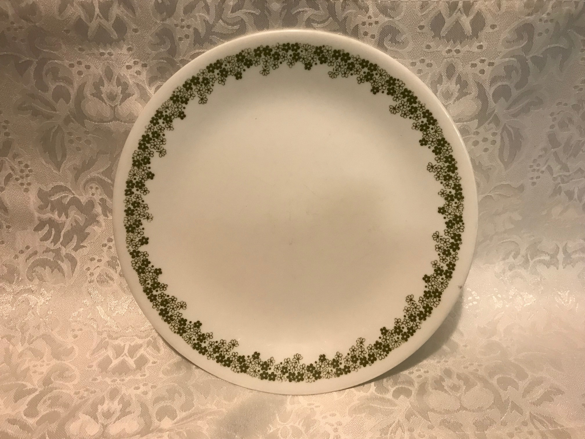 Corelle Plate With Crazy Daisy Spring Blossom Green Border Pattern: 15,200 ppm Lead + Cadmium