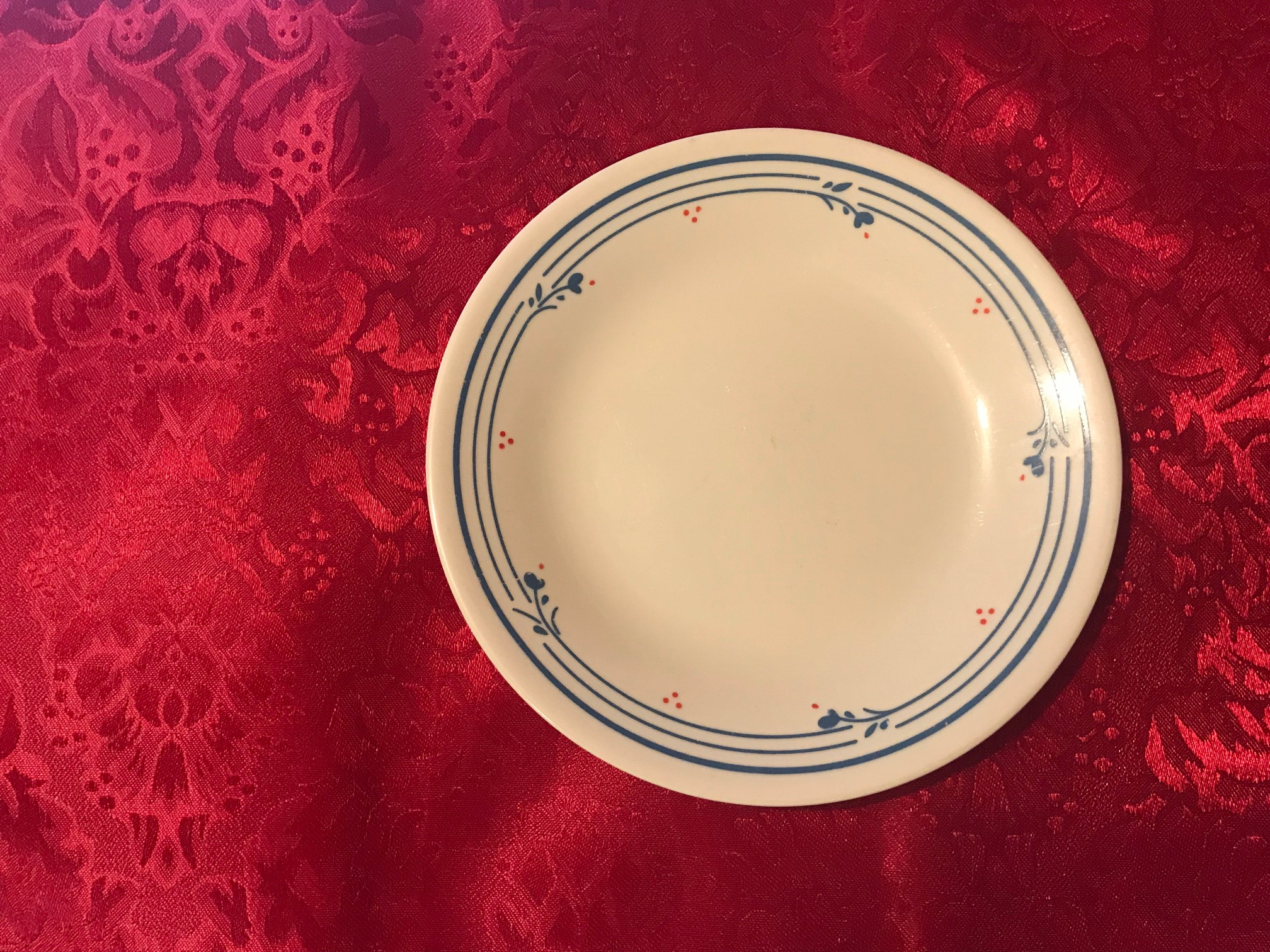 Small Cream Corelle Plate With Blue Floral Border & Red Berries: 7,450 ppm Lead + Cadmium