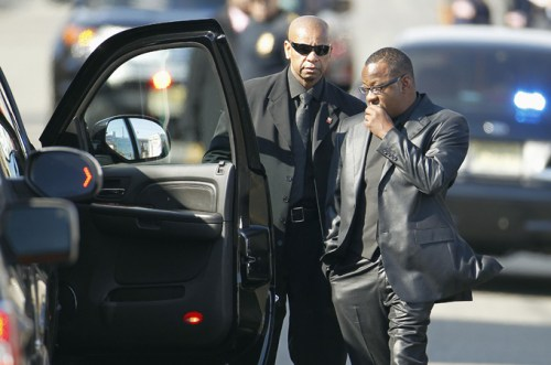 Bobby Brown leaving Whitney's funeral.