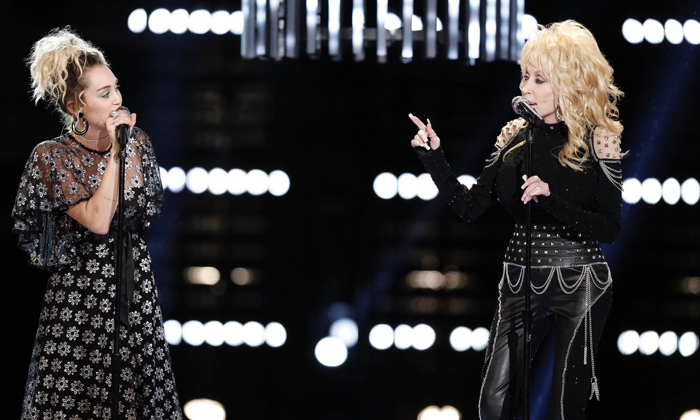 "THE VOICE -- ""Live Top 10"" Episode 1116B -- Pictured: (l-r) Miley Cyrus, Dolly Parton -- (Photo by: Tyler Golden/NBC)"