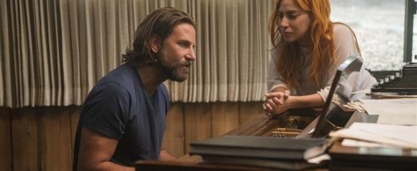 Bradley Cooper playing Piano Lady Gaga Stares lovingly