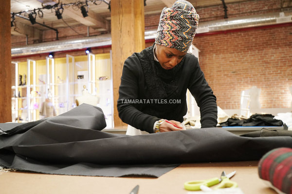 Renee Hill in a headwrap working in work room