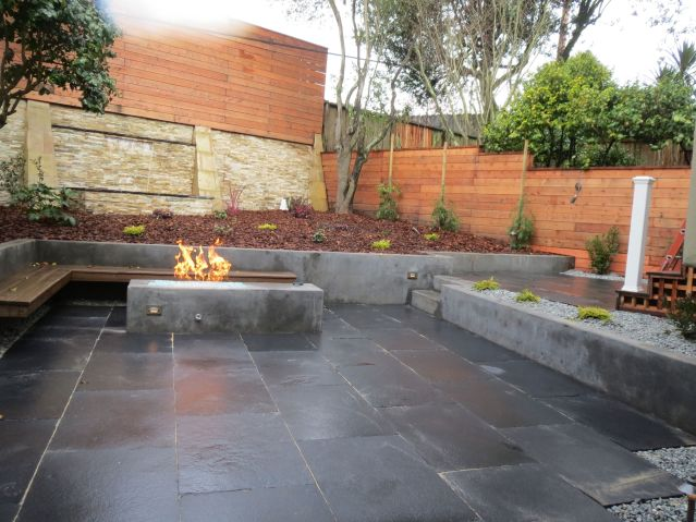custom stone patio with gas fire pit