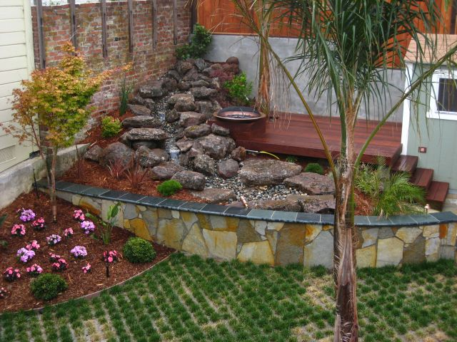 deck over custom fountain and pond