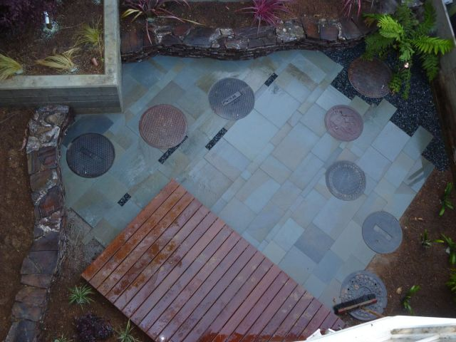 customized patio and deck construction with manhole covers