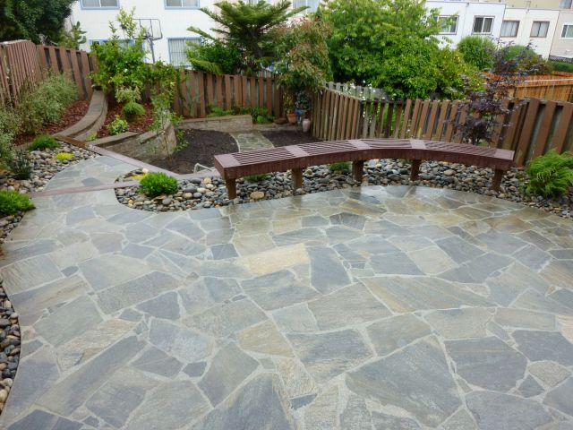 custom patio construction with retaining wall and bench