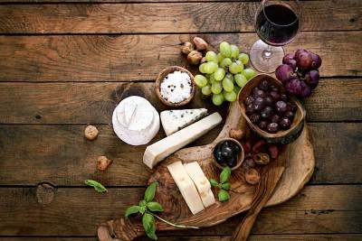 Cheese plate with wood background
