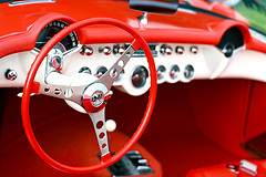 red dashboard of old car