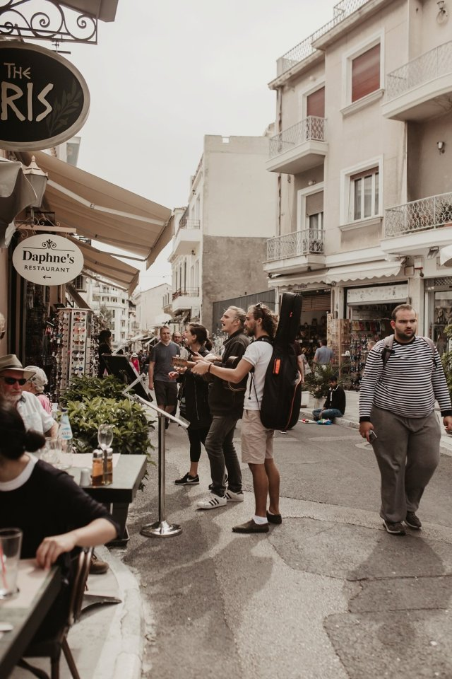 Musicians playing music to tourists in The streets of Plaka in Athens Greece by Tami Keehn.