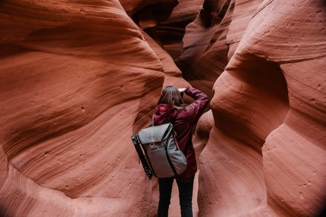 A woman photographing Antelope Canyon X in Page Arizona by photographer Tami Keehn