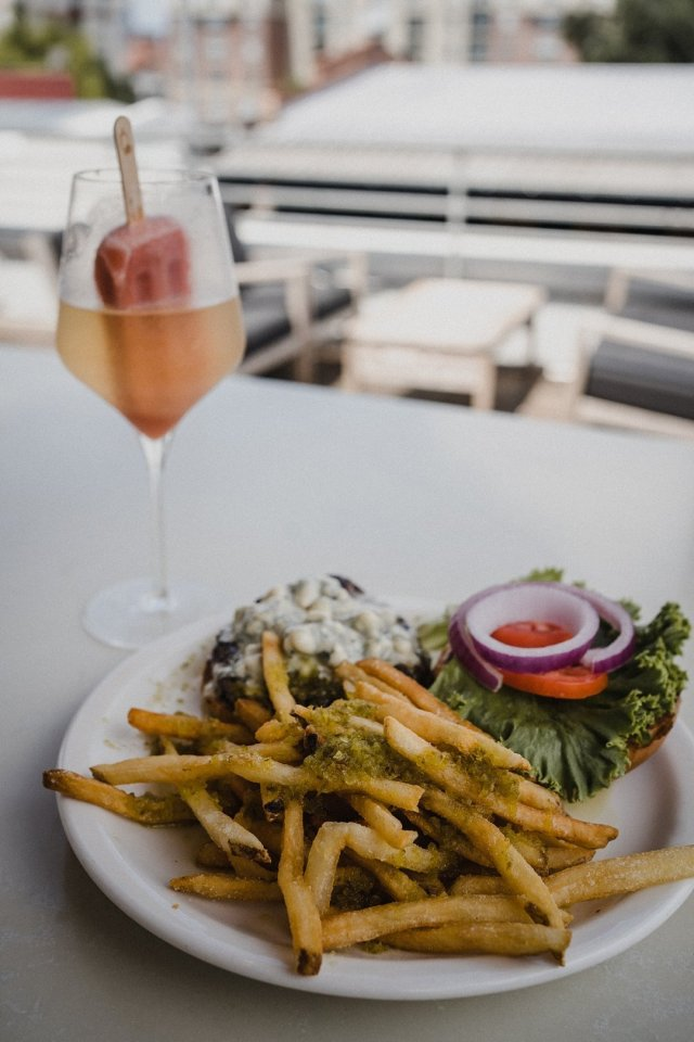 The grove burger, honey drizzle fries and champagne pop at the grove in Savannah, GA.