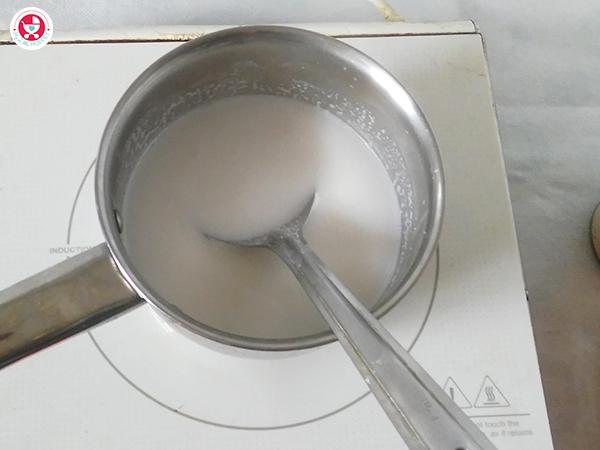 adding rice into pan