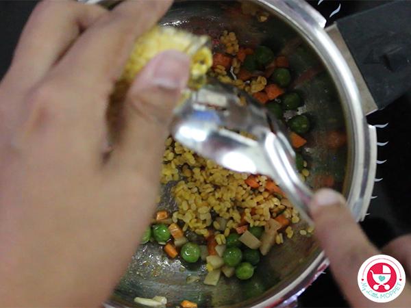 Add carrot, potato and green peas