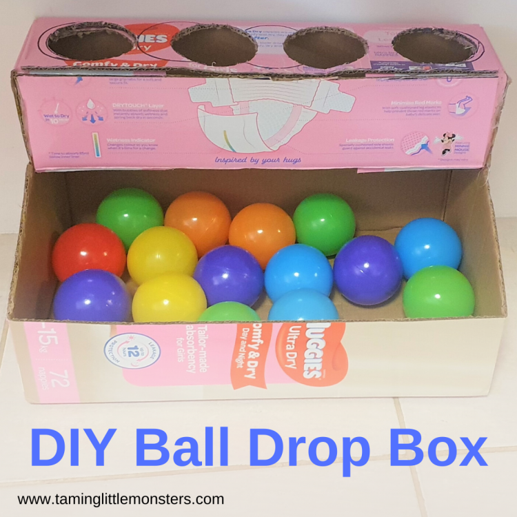 Recycle an old box and learn how to make this DIY Ball Drop Box. A fun and easy fine motor activity for babies and toddlers.