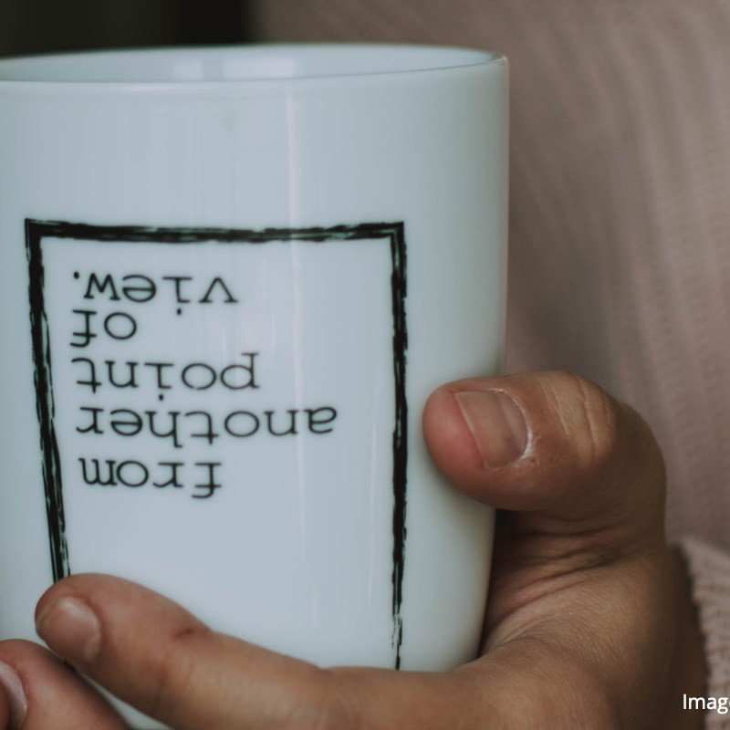 """Coffee cup that says, """"From another point of view"""""""