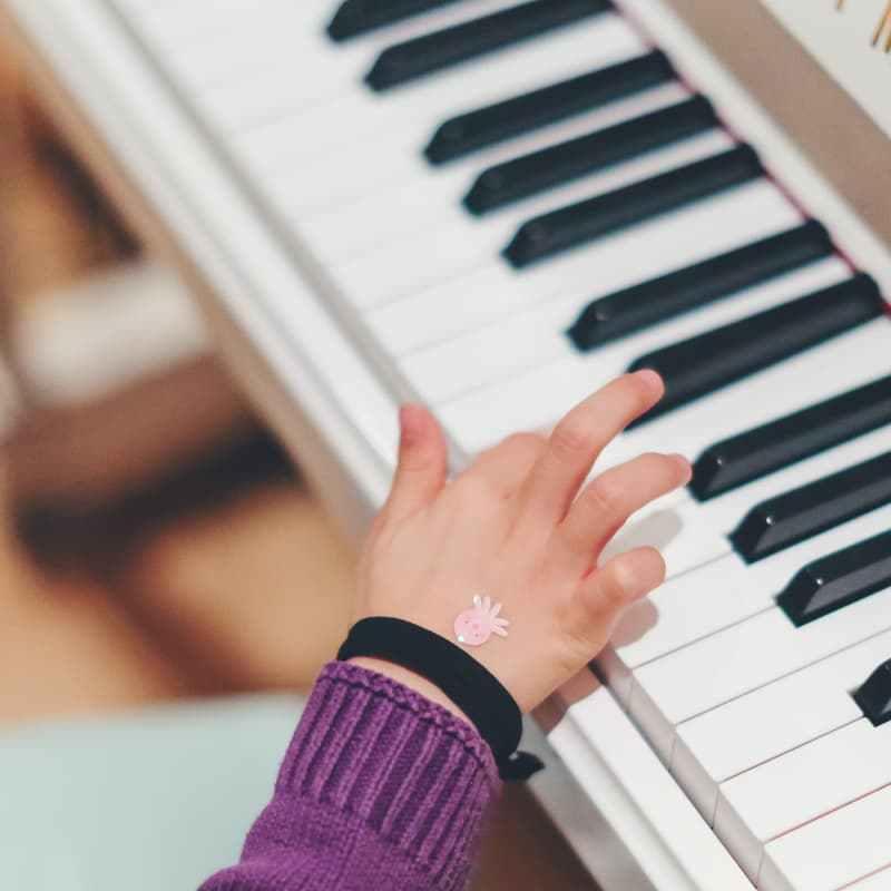 child practicing piano