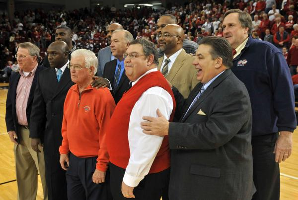 Players and staff members of Bradley's 1981-82 team that won the NIT was honored at halftime during Wednesday night's game at Renaissance Coliseum. Front row, from left, are sports information director Joe Dalfonso, player Willie Scott, athletics director Ron Ferguson, manager Eugene Link and associate head coach Tony Barone. In the back row, from left, are players Mitchell Anderson, Pierre Cooper, Eddie Mathews, Donald Reese, Barney Mines and assistant coach Jay Eck.