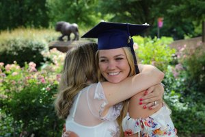 Me hugging daughter with graduation hat