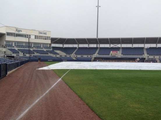 The tarp is on the field in Pt. Charlotte, though the game is still expected to go on. (Photo courtesy of Marc Topkin/Tampa Bay Times)
