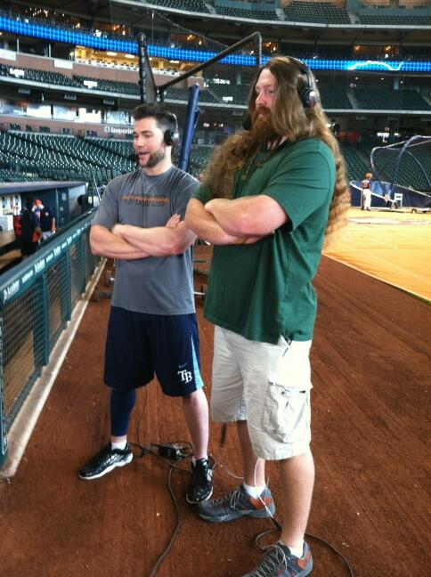 Luke Scott and his brother Noah being interviewed. Is it really surprising that he hasn't had a haircut in five years? (Photo courtesy of Tampa Bay Rays director of communications Dave Haller)