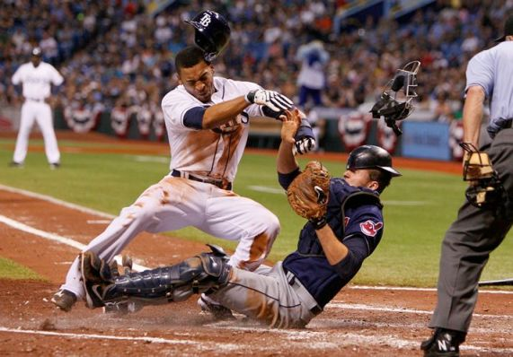 Desmond Jennings, showing off his football skills, plows into catcher Lou Marson trying to beat a throw in the third inning. Jennings is out, Marson later leaves with a neck strain, and, the Rays believe, Evan Longoria is hit by a pitch in retaliation. DANIEL WALLACE | Times