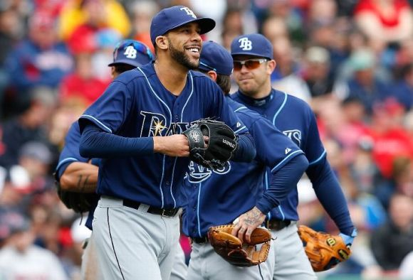 BOSTON, MA - APRIL 13: David Price #14 of the Tampa Bay Rays reacts after his catcher Jose Molina #28 was treated for a minor injury in the fifth inning at Fenway Park on April 13, 2013 in Boston, Massachusetts. (Photo by Jim Rogash/Getty Images)