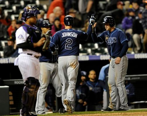 The Rays' Kelly Johnson is congratulated after hitting a two-run homer off Rockies reliever Matt Belisle in the 10th inning. (Photo courtesy of the Associated Press)