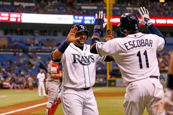 Yunel Escobar and Jose Molina celebrate after scoring in the fourth inning against the Boston Red Sox. (Photo by J. Meric/Getty Images)