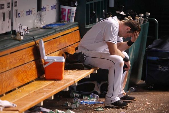 Evan Longoria contemplates his 0-for-4 night that includes striking out with the tying run at third. (Photo courtesy of Chris Zuppa/Times)