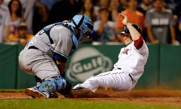 Jose Molina ends the eighth inning by tagging out Daniel Nava, who challenged Sam Fuld's arm after a flyout to left-center. (Photo courtesy of Getty Images)