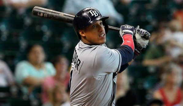 Yunel Escobar hits a line drive into right field for a double, scoring Jose Lobaton, during the eleventh inning Thursday.  (Photo courtesy of AP Photo/Patric Schneider)