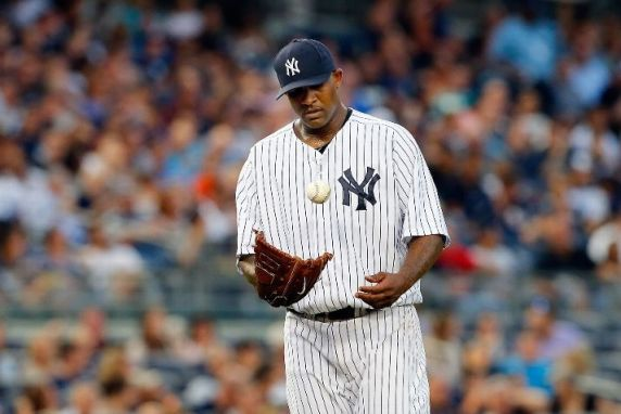 CC Sabathia tosses the ball after surrendering a run in the second inning against the Tampa Bay Rays. (Photo by Jim McIsaac/Getty Images)