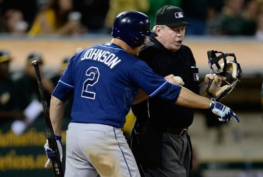 Kelly Johnson argues with home plate umpire Brian Gorman after being called out on strikes in the eighth inning. A pictorial metaphor of the Rays at the moment. (Photo courtesy of Getty Images)