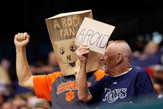 Fans express their views on Alex Rodriguez during the game between the Tampa Bay Rays and the New York Yankees. (Photo by J. Meric/Getty Images)
