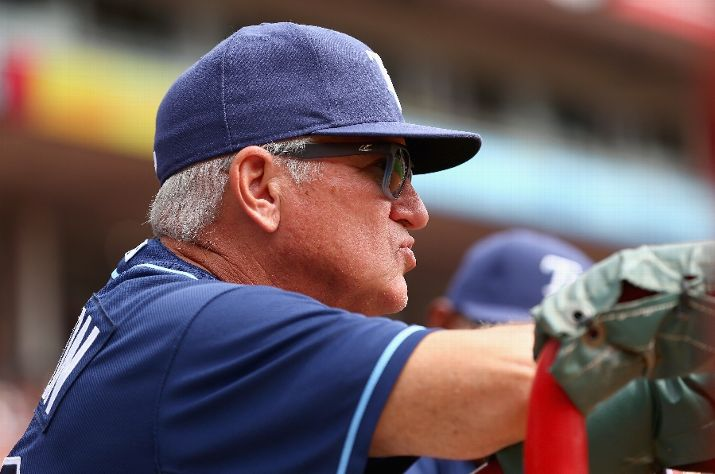 Joe Maddon watches the action during the game against the Cincinnati Reds Sunday. I can only imagine what's going through his head at this very moment. (Photo by Andy Lyons/Getty Images)