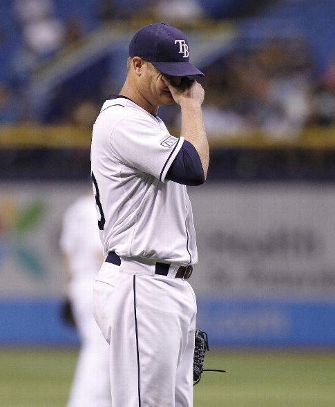 Alex Cobb reacts on the mound after getting hit by a comeback single off the bat of Russell Martin. (Photo courtesy of Brian Blanco/Getty Images)
