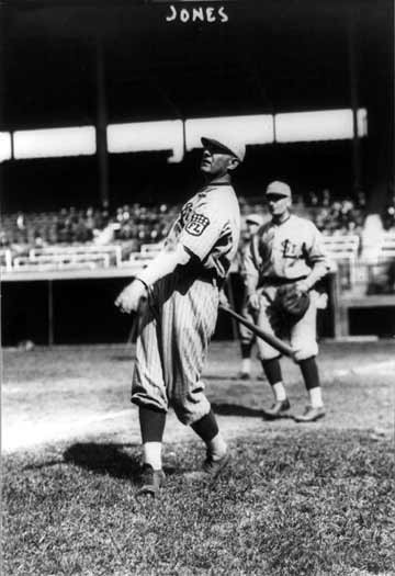 Photograph shows Fielder Allison Jones, baseball player for the St. Louis Terriers facing left, in uniform, swinging bat. The photo dates to 1914.