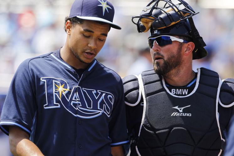 Chris Archer and Bobby Wilson talk after the first inning of a Spring Training game between the Tampa Bay Rays and Toronto Blue Jays on Wednesday, March 18, 2015. (Photo courtesy of Will Vragovic/Tampa Bay Times)