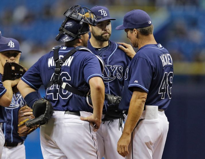 Jim Hickey talks to Nathan Karns and Bobby Wilson as Karns struggled during the first inning. (Photo credit  Chris O'Meara/AP Photo)