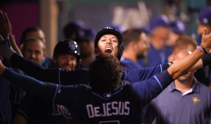 Steven Souza Jr. celebrates his three-run home run in the dugout with David DeJesus during the sixth inning on Wednesday. (Photo credit: AP Photo/Mark J. Terrill)