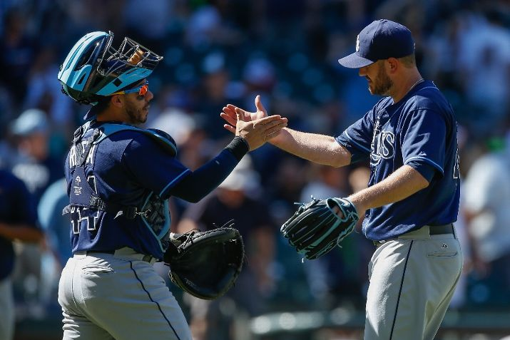 Kevin Jepsen is congratulated by Rene Rivera after defeating the Seattle Mariners 3-1 on Sunday. (Photo Credit: Otto Greule Jr/Getty Images)