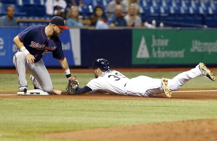 I'd easily call this a microcosm of Wednesday night's game. Trevor Plouffe catches Kevin Kiermaier attempting to advance after tagging up on a pop out by Rene Rivera. (Photo Credit: Brian Blanco/Getty Images)