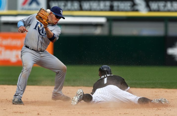 Adam Eaton steals second on a throw from Tampa Bay Rays catcher Curt Casali that hit shortstop Asdrubal Cabrera on the head, during the 10th inning on Wednesday. (Photo Credit: AP Photo/Charles Rex Arbogast)
