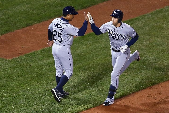 Third base coach Charlie Montoyo congratulates Evan Longoria after he crushed homer number 204 over the Monstah on September 24, 2015 in Boston, Massachusetts. (Photo by Maddie Meyer/Getty Images)