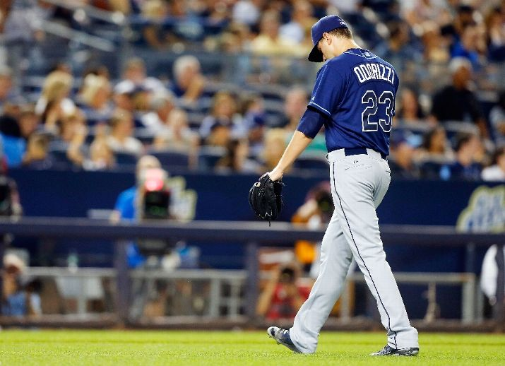 Jake Odorizzi walks to the dugout as he leaves a game in the seventh inning. (Photo Credit: Jim McIsaac/Getty Images)