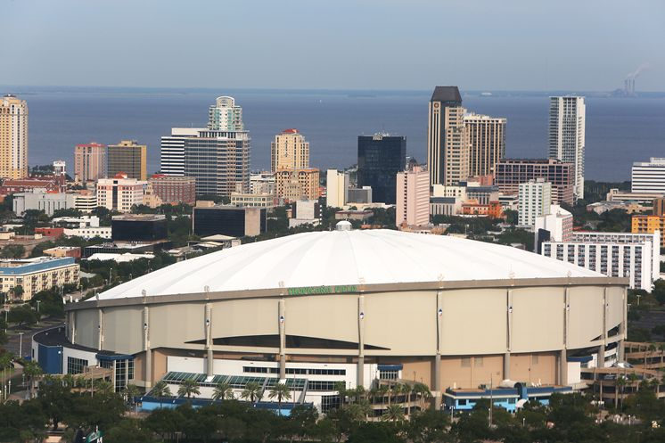Tropicana Field is shown in the shadow of the skyline of downtown St. Petersburg in 2013. (Photo Credit: Tampa Bay Times)