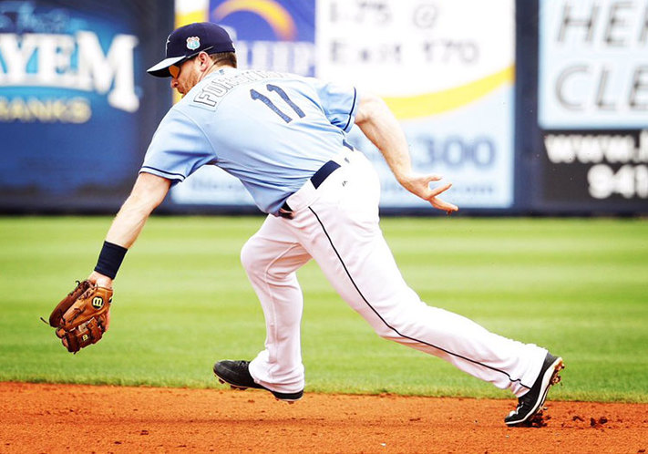 Logan Forsythe ranges to his right to field a grounder against the Twins on Friday. (Photo Credit: Tampa Bay Times)
