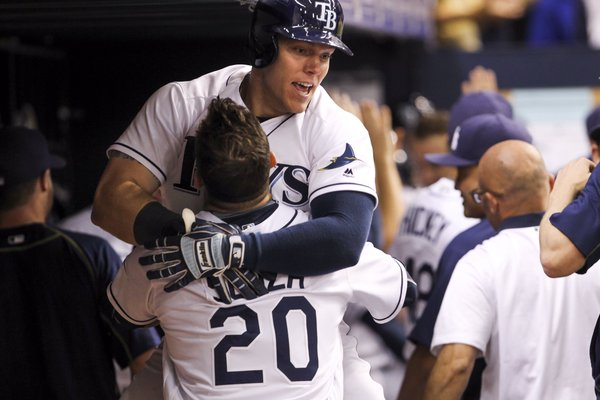 Logan Morrison jumps into the arms of Steven Souza Jr. arms after his sixth inning, game tying two-run homer. (Photo Credit: Will Vragovic/Tampa Bay Times)